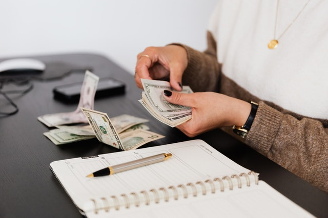 counting money for debt consolidation with the help of harrison funding